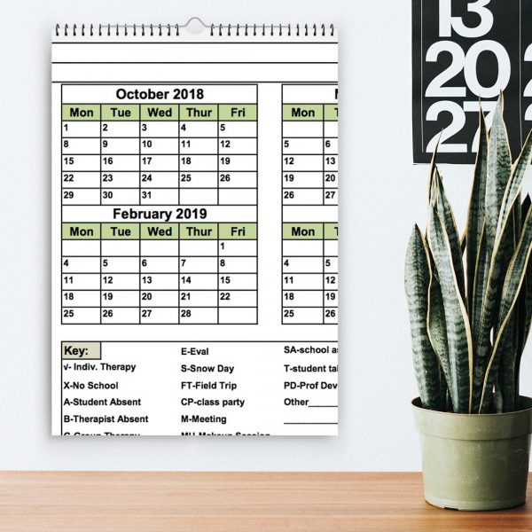 Rendering of the SMARTER Steps Attendance Calendar hanging on the wall over a desk