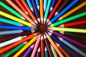 Colored pencils arranged in a circle to form a target